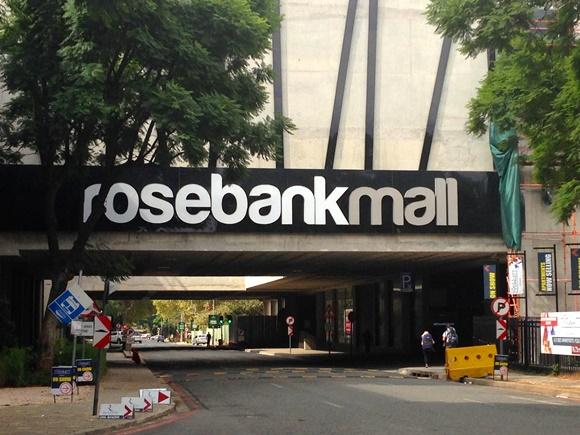 Entrada do Rosebank Mall com letreiro acima Blog Vem Por Aqui